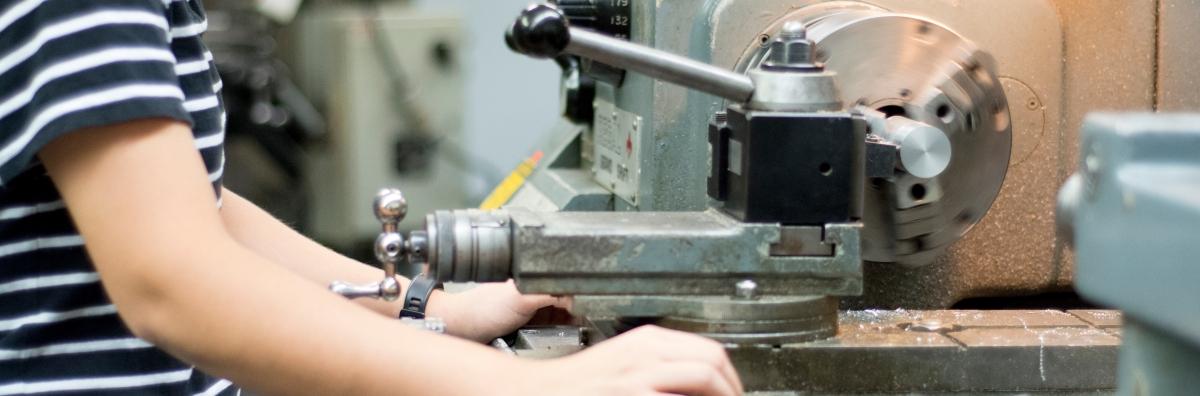 student working with machine